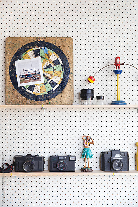 Pegboard / Perforated board with shelves in a studio office by Natalie JEFFCOTT for Stocksy United