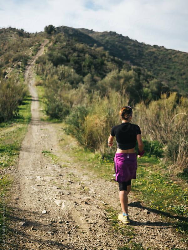 Hispanic runner girl from behind ascending by Martin Matej for Stocksy United