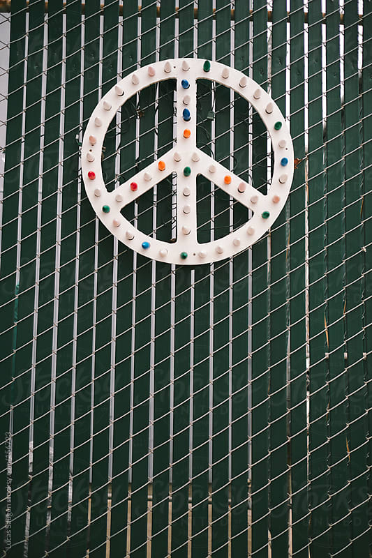 Peace sign with some large christmas light bulbs on it. by Lucas Saugen for Stocksy United