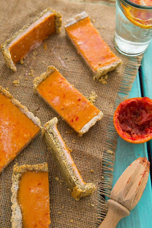 Blood orange tart slices  by Aniko Lueff Takacs for Stocksy United