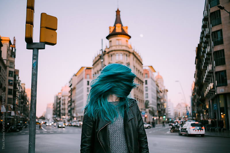 Blue haired woman at sunset in the city  by Thais Ramos Varela for Stocksy United