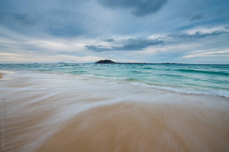 Corralejo beach with view of Los Lobos, Fuerteventura by Gabriel Ozon for Stocksy United