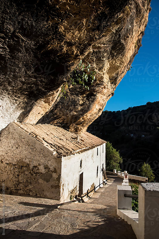 A house cave on a rock in Montefrio, Andalusia, Spain by Bisual Studio for Stocksy United