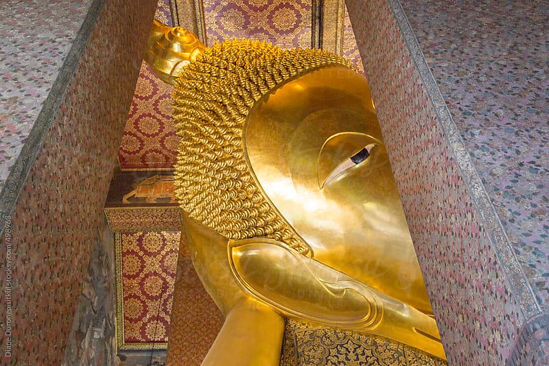 Leaning Buddha's Eye by Diane Durongpisitkul for Stocksy United