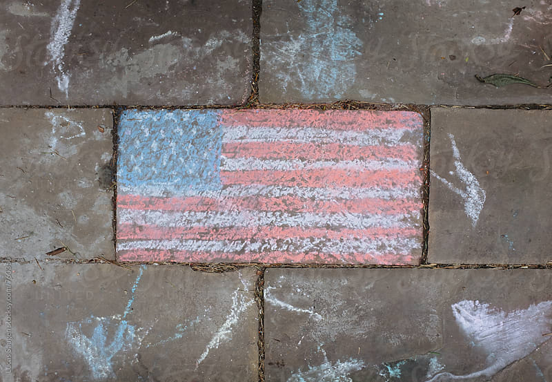 An American Flag on a sidewalk. by Lucas Saugen for Stocksy United
