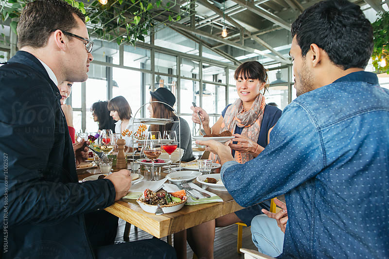 Lunch With Friends - Group of Seven Good-Looking Young People Eatling Mediterranean Lunch at Bright Stylish Restaurant by Julien L. Balmer for Stocksy United