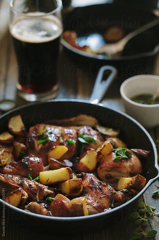 Roasted rabbit with potatoes by Davide Illini for Stocksy United