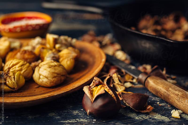 Peeled roasted chestnuts by Gabriel (Gabi) Bucataru for Stocksy United