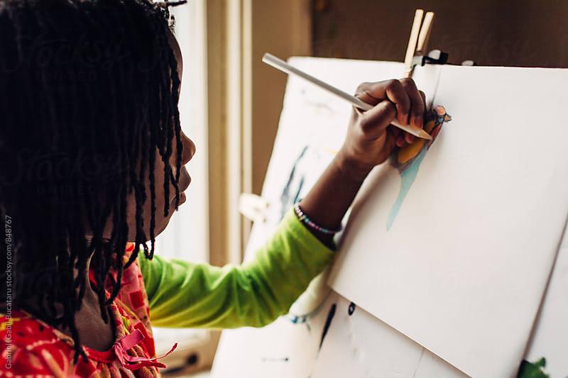 African American girl drawing by Gabriel (Gabi) Bucataru for Stocksy United