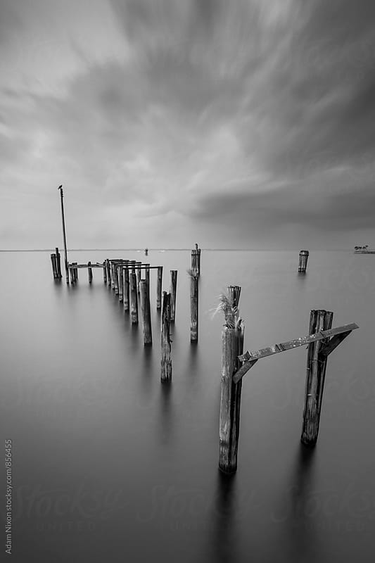 Old abandoned wood boat dock by Adam Nixon for Stocksy United