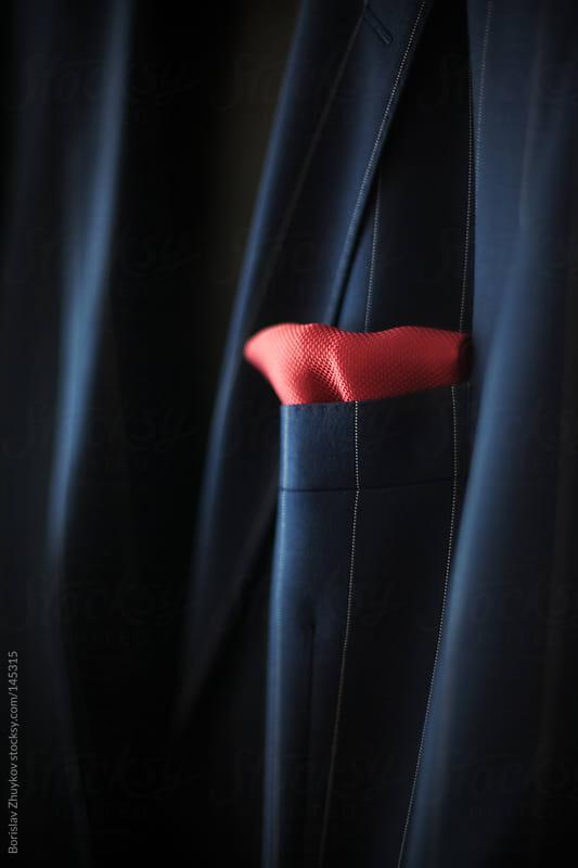Detail of groom's coat  by Borislav Zhuykov for Stocksy United