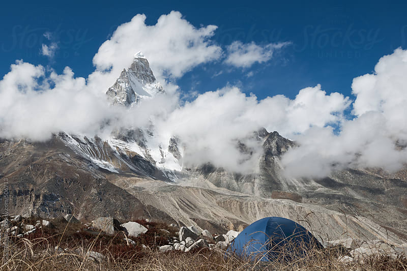 mountain with tent  by RG&B Images for Stocksy United