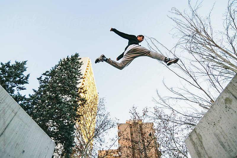 Man jumping during a parkour training by Inuk Studio for Stocksy United