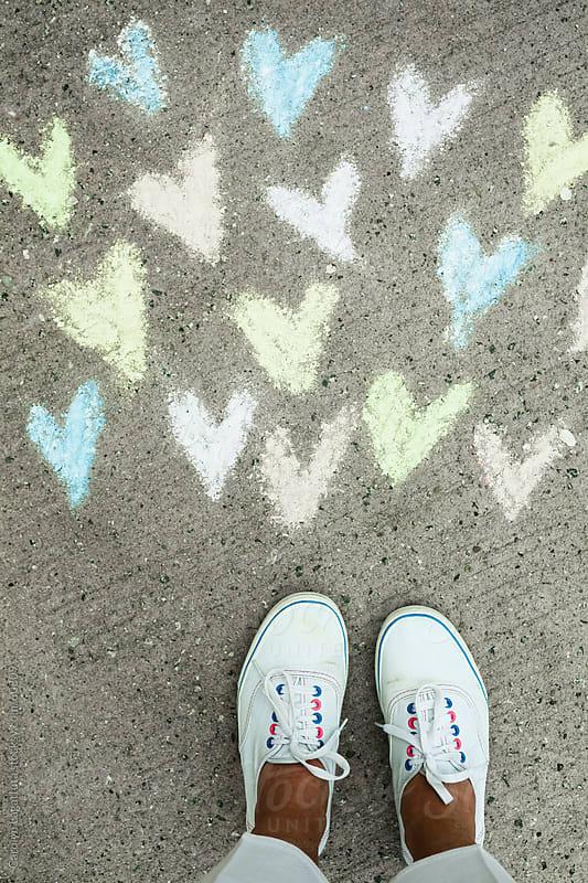 Pastel chalk hearts on the sidewalk and white tennies by Carolyn Lagattuta for Stocksy United