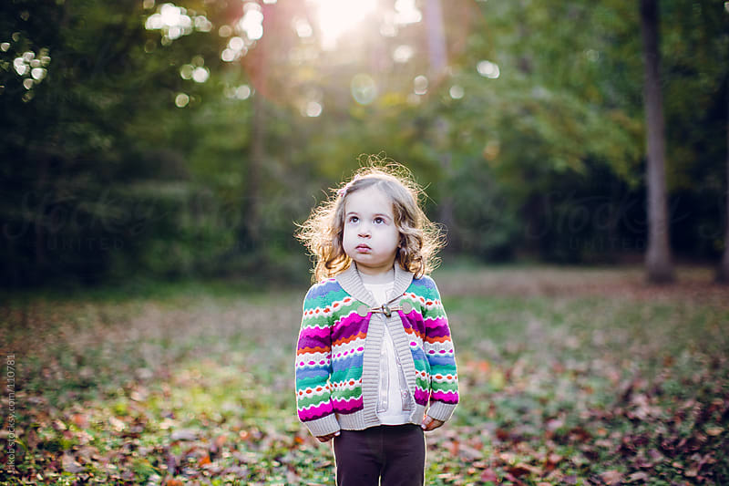 Toddler standing in a park during fall by Jakob for Stocksy United