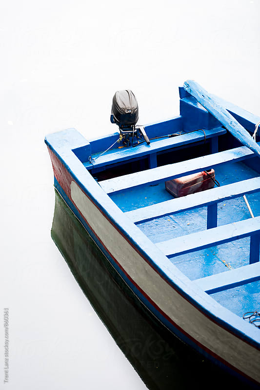 Close-up of blue motor boat on still water by Trent Lanz for Stocksy United