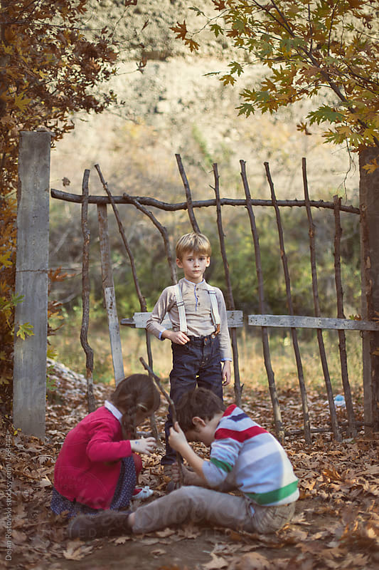 Autumn play in rural garden by Dejan Ristovski for Stocksy United
