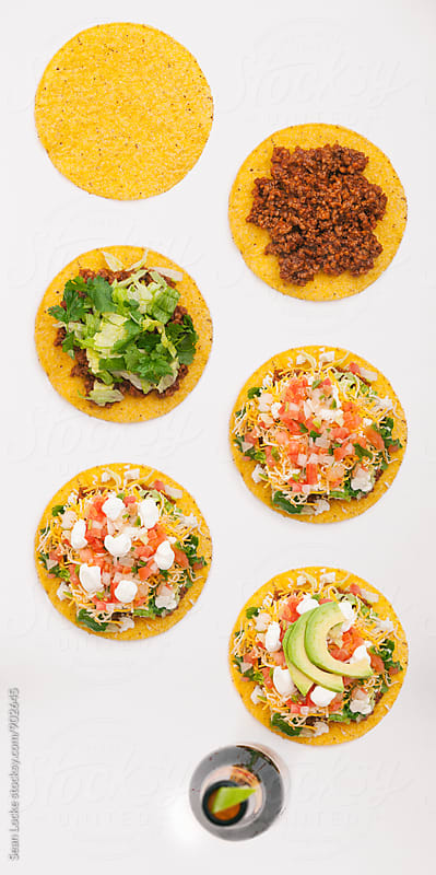Tacos: Image Series Of Tostada Being Constructed With Beer by Sean Locke for Stocksy United