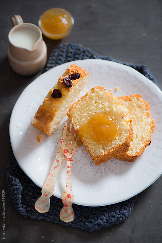 Slice of coconut and almond plumcake by Laura Adani for Stocksy United