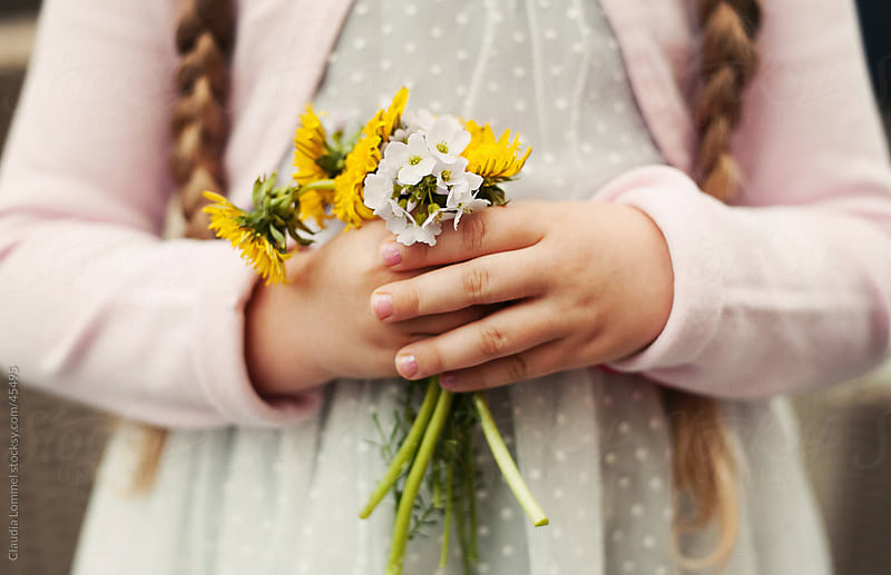 A Girl's Hands Holding a Small Bouquet of Flowers that are Picked by Herself by Claudia Lommel for Stocksy United