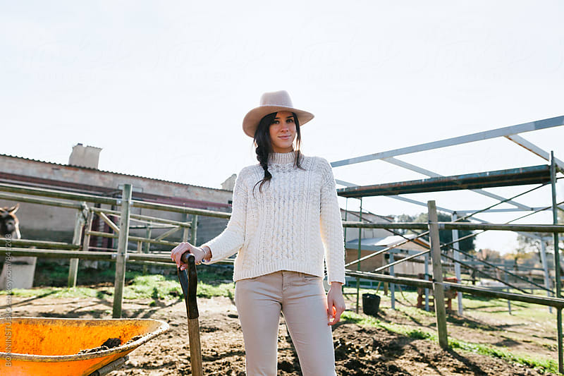 Portrait of a woman farmer outside. by BONNINSTUDIO for Stocksy United