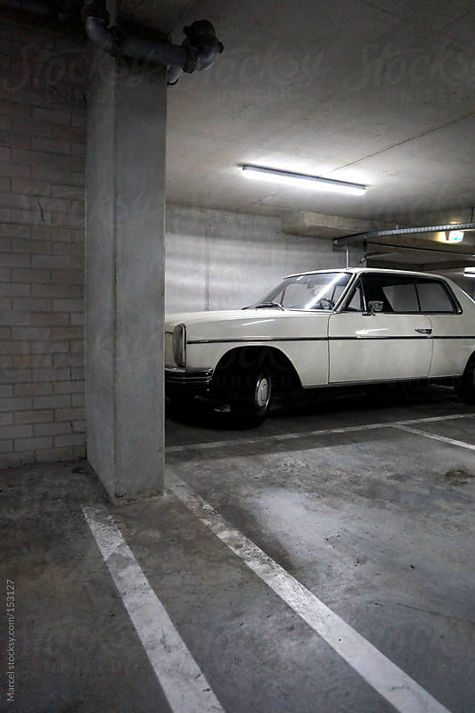Vintage car in parking garage by Marcel for Stocksy United