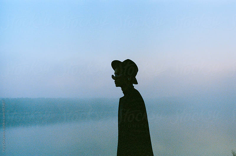 Portrait of young man in a hat and glasses in the water by Yury Goryanoy for Stocksy United