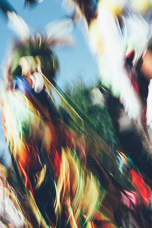 Native American Indian pow wow dancers, long exposure abstract by Paul Edmondson for Stocksy United