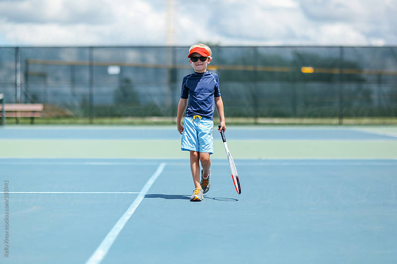 a young boy is ready to play tennis by Kelly Knox for Stocksy United