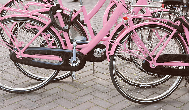 pink bicycles in the street by Sonja Lekovic for Stocksy United