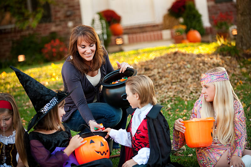 Halloween: Kids Are Happy to Get Halloween Candy by Sean Locke for Stocksy United