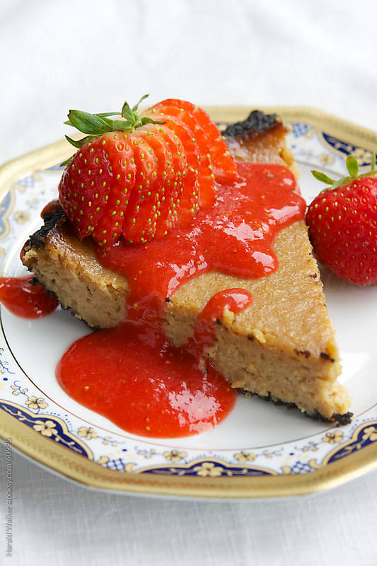 Vegan Cheesecake with a Chocolate Bottom and Strawberry Coulis by Harald Walker for Stocksy United
