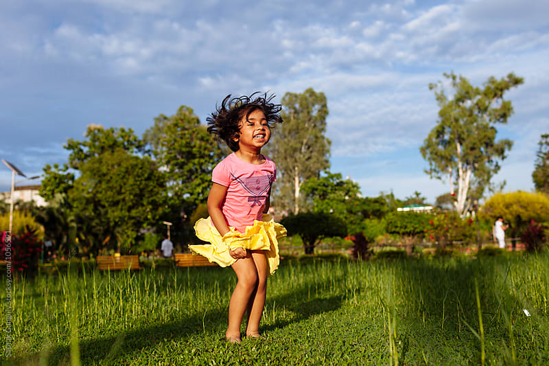 Little girl having fun in the park by Saptak Ganguly for Stocksy United