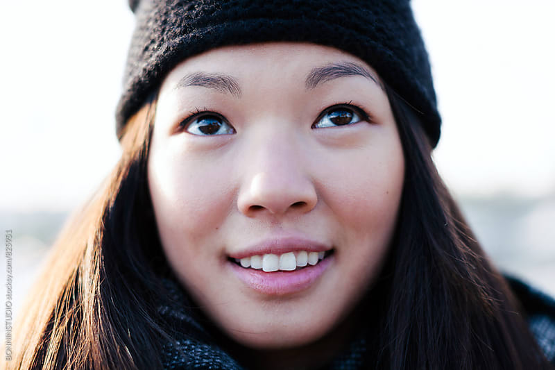 Closeup portrait of a chinese woman outside. by BONNINSTUDIO for Stocksy United