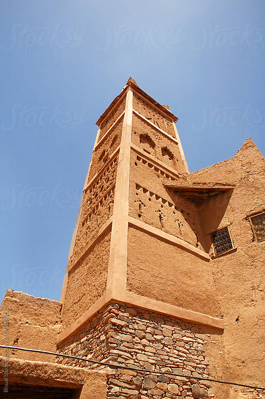Fortified mudbrick kasbah in the Draa Valley, Morocco by Bisual Studio for Stocksy United