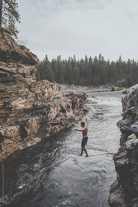 Slacklining across waterfalls by Luke Gram for Stocksy United