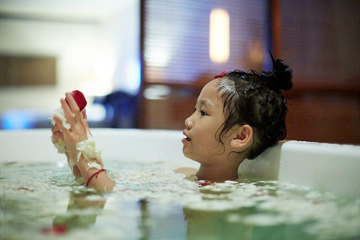 Cute Asian Little Girl Bathing In A Bathtub Full Of Petals ...