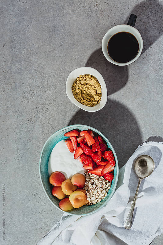 Muesli and coffee by Tatjana Ristanic for Stocksy United