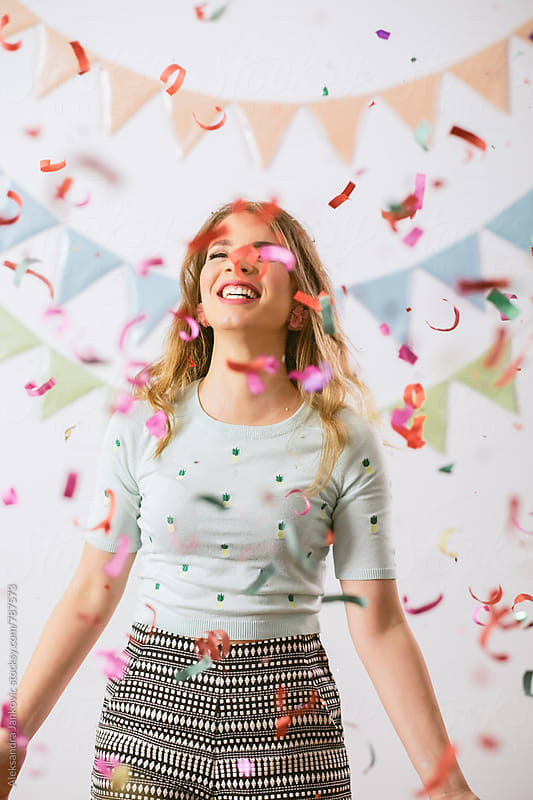 Happy Girl and Confetti by Aleksandra Jankovic for Stocksy United
