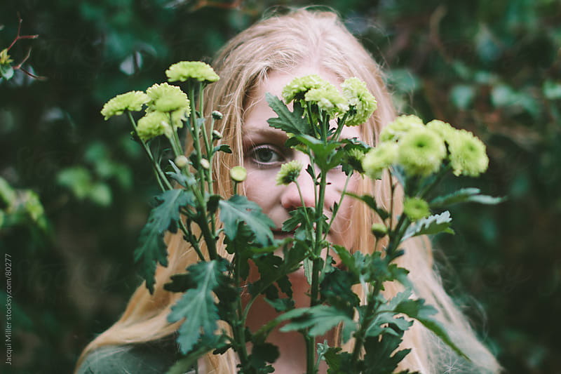 Girl with green flowers by Jacqui Miller for Stocksy United