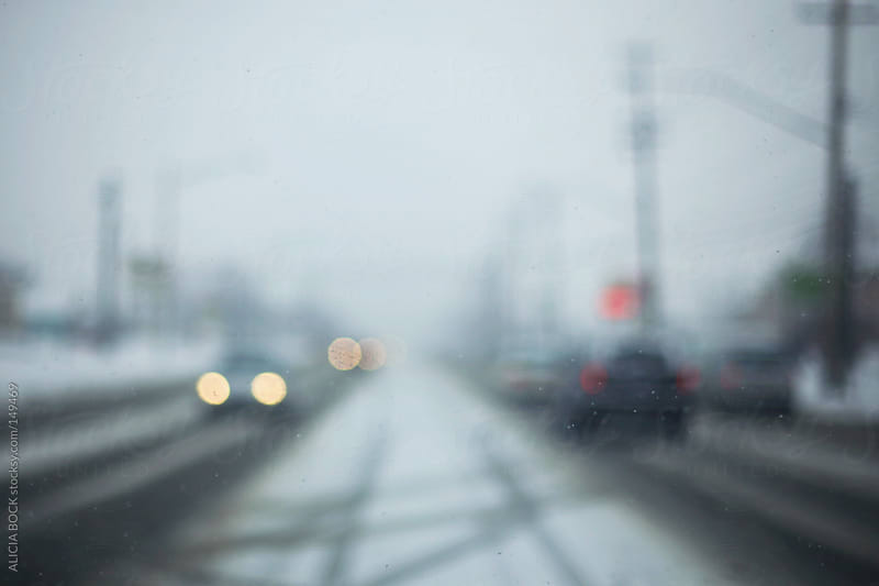 Abstract Headlights And Cars On A Snow Covered Winter Road by ALICIA BOCK for Stocksy United