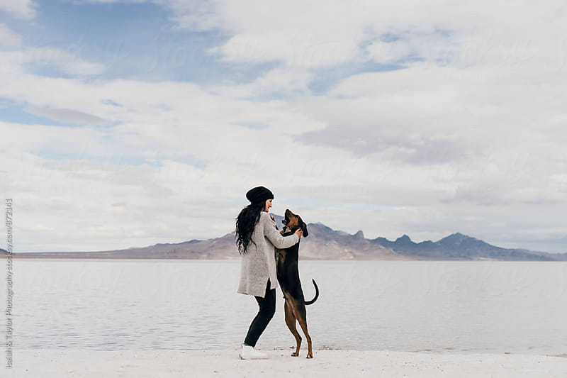 Dog hugging woman by Isaiah & Taylor Photography for Stocksy United