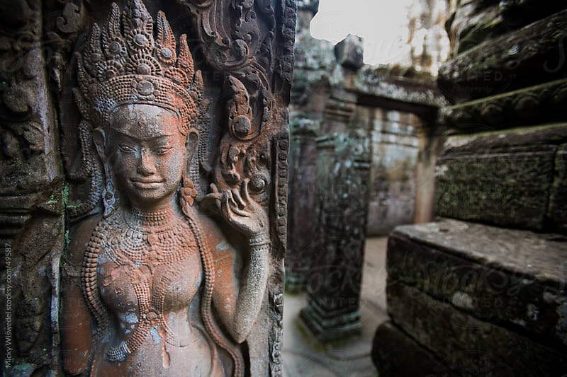 Ancient carvings at Bayan temple in Angkor Wat, Cambodia by Micky Wiswedel for Stocksy United