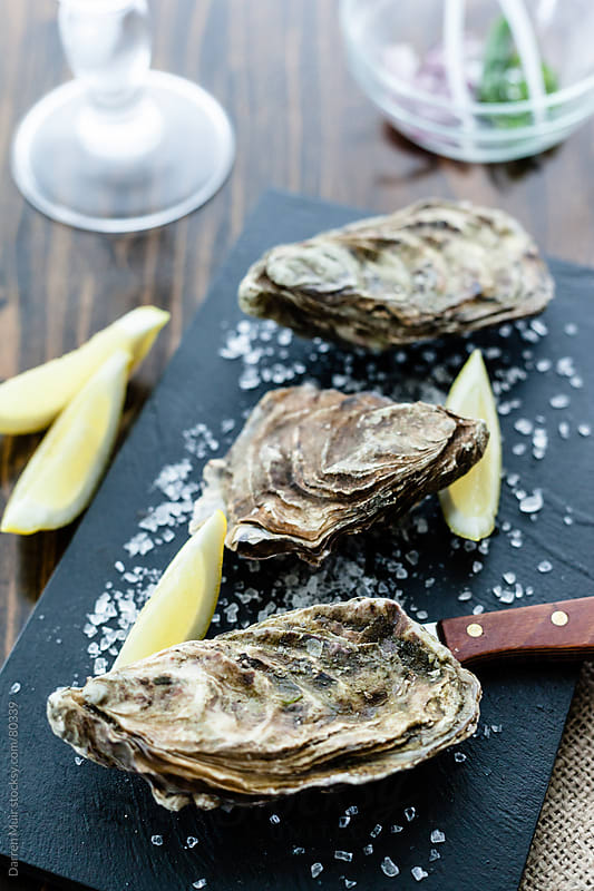 Trio of Oysters.  by Darren Muir for Stocksy United