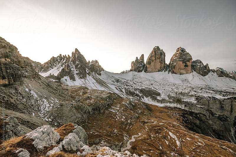 rough snowcovered landscape at the three peaks in the italian alps by Leander Nardin for Stocksy United