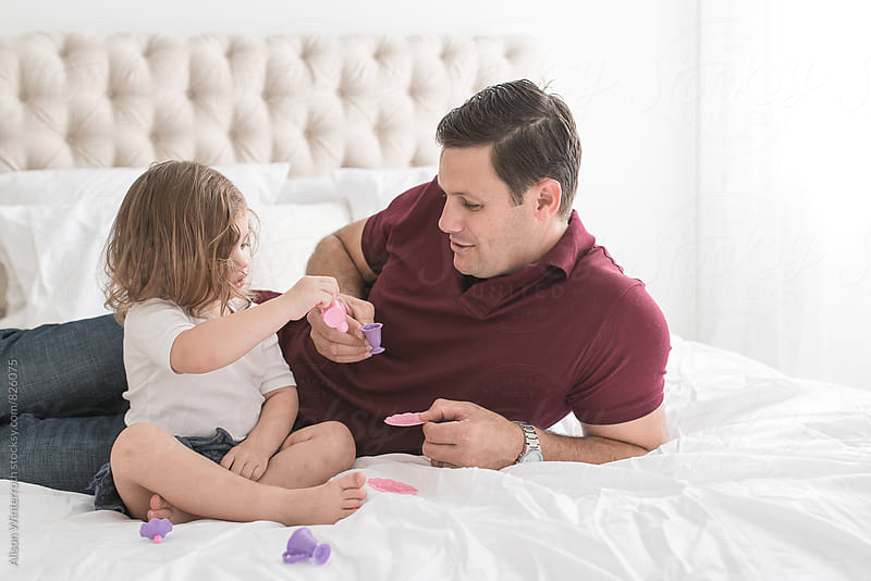Father And Daughter Drinking Tea by Alison Winterroth for Stocksy United