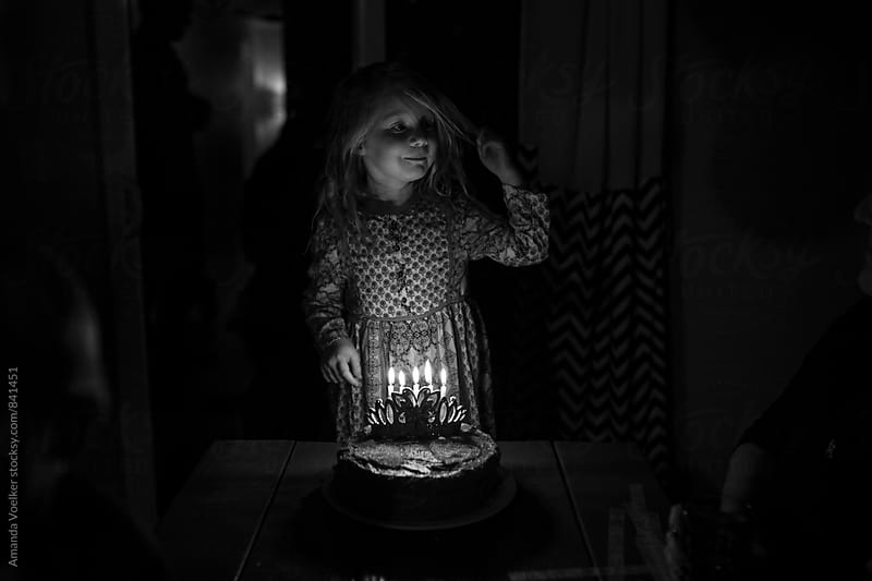 Little Girl Waiting to Blow out Birthday Candles by Amanda Voelker for Stocksy United