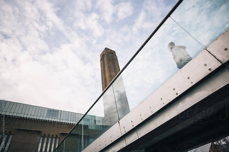 Man walking on the millennium bridge by michela ravasio for Stocksy United