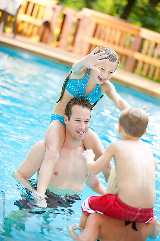 Swimming: Playful Family Having Fun by Sean Locke for Stocksy United
