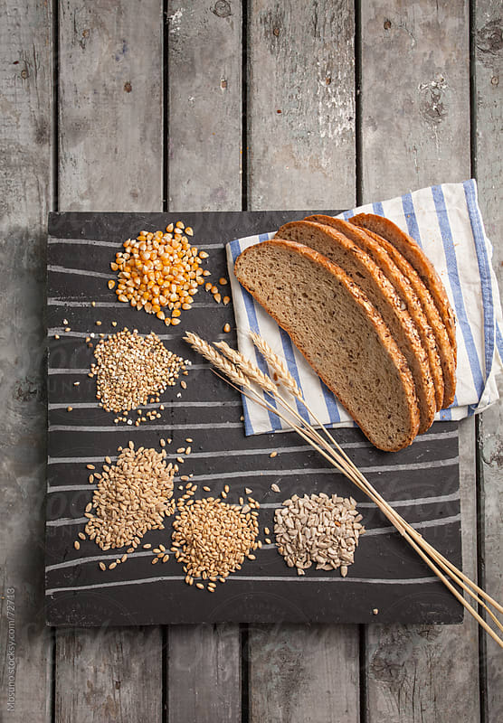 Organic Grains and Bread on a Plate by Mosuno for Stocksy United